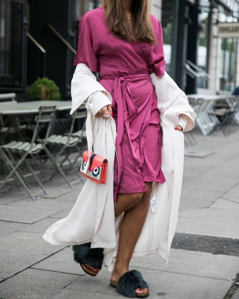 With purple knee-length dress, white coat and printed mini bag