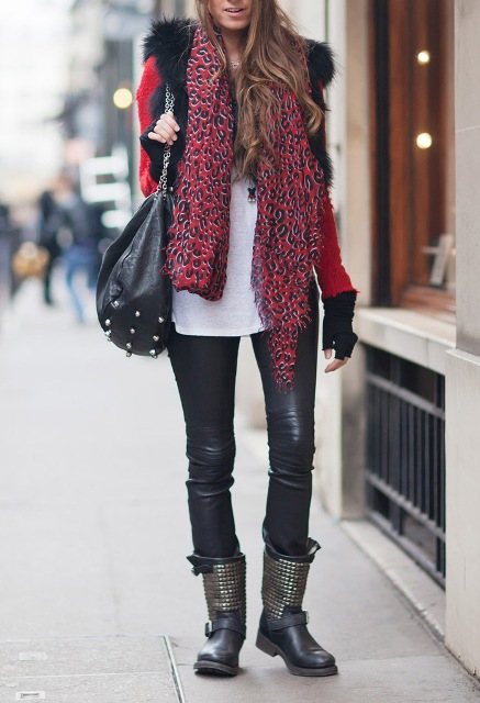 With red shirt, fur vest, black tote, black leather pants and printed scarf