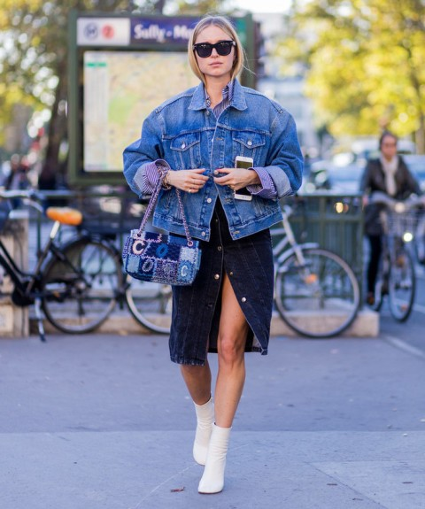 a trendy look with a denim jacket and a denim skirt