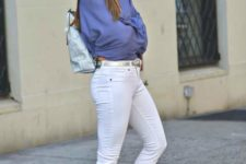 With silver backpack, white skinny pants, white sneakers and shirt