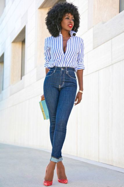 With skinny jeans, clutch and red pumps