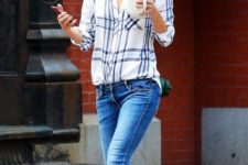 With skinny jeans, sunglasses and flat shoes