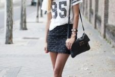 With t-shirt, black bag and ankle strap shoes