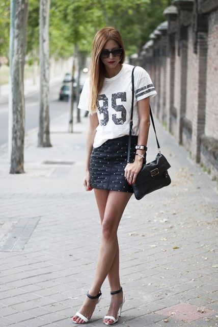 With t shirt, black bag and ankle strap shoes