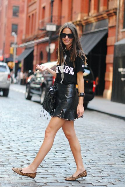 With t shirt, black bag and leopard flats