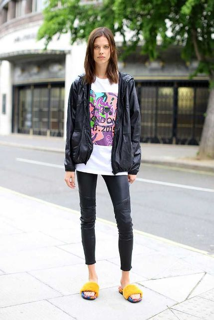 With t-shirt, black jacket and black leather pants