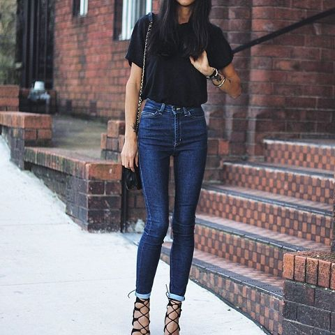 With t-shirt, chain strap bag and lace up heels