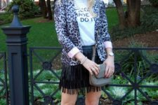 With t-shirt, fringe skirt, small bag and pumps