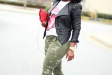 With t-shirt, khaki pants, red and black shoes and red clutch