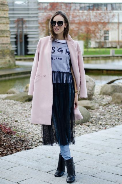 With t-shirt, pale pink coat and black ankle boots