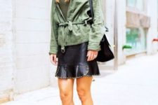 With top, olive green jacket, black bag and shoes