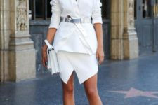With white blazer, mini skirt, white bag and ankle strap shoes