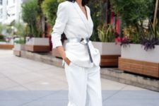 With white blazer, white cropped trousers and pale pink pumps