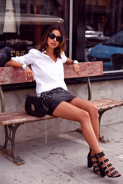 With white button down shirt, small bag and black embellished shoes