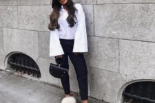 With white button down shirt, striped trousers, black bag and white cardigan