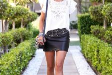 With white lace blouse, black wide brim hat, bag and embellished boots