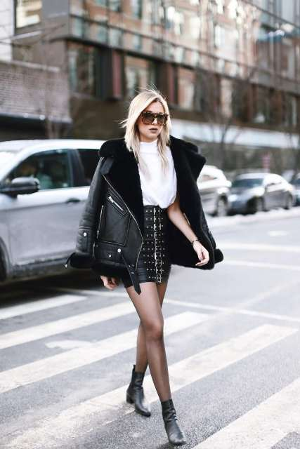 With white loose shirt, leather jacket and black boots