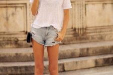 With white loose t-shirt, denim shorts and black chain strap bag