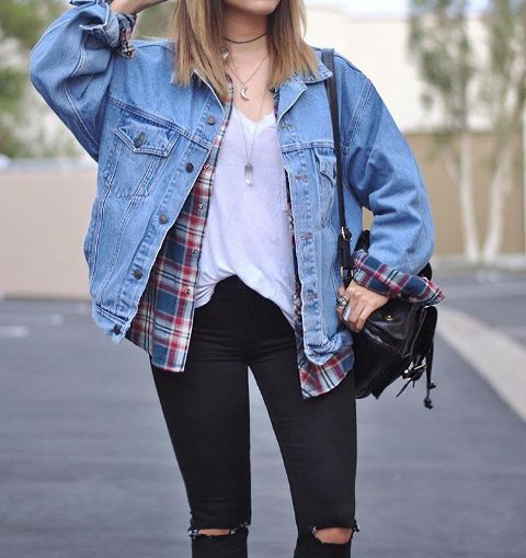 With white loose t-shirt, plaid shirt, distressed pants and black backpack