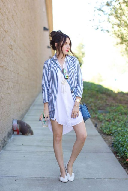 With white mini dress, blue bag and white flats