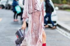 With white mini dress, fur bag and red high boots