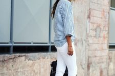 With white pants, black bag and heeled sandals