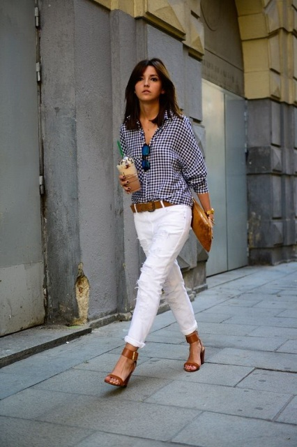 With white pants, brown belt, brown clutch and ankle strap shoes