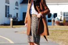 With white shirt, brown belt, brown coat and platform shoes
