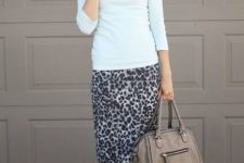 With white shirt, gray bag and black cutout boots