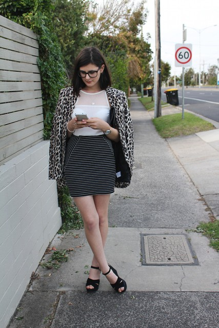With white shirt, striped mini skirt and black platform sandals