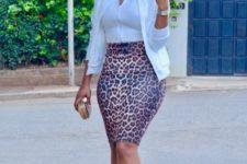 With white shirt, white blazer and high heels