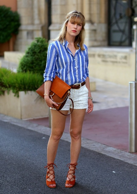 With white shorts, brown belt, brown bag and red lace up high heels