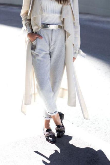 With white sweater, black embellished shoes, beige coat and light gray pants
