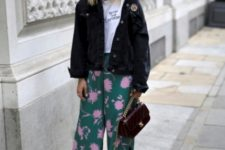 With white t-shirt, black jacket, flat shoes and chain strap bag