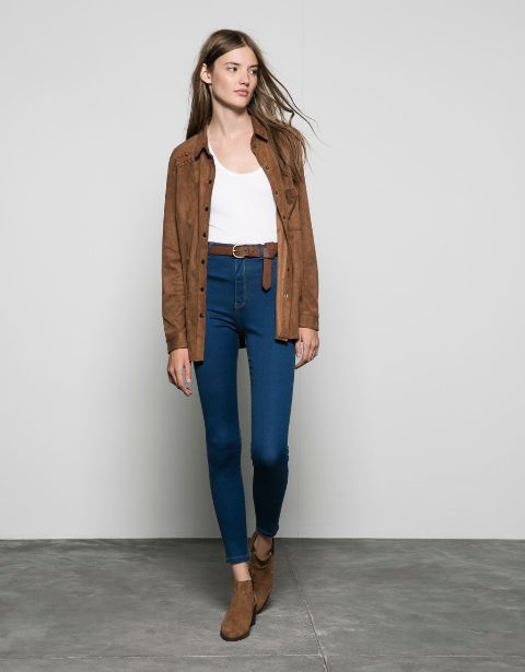 With white t-shirt, brown jacket and brown suede boots