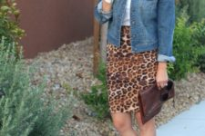 With white t-shirt, denim jacket, brown leather clutch and shoes