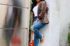 With white t-shirt, distressed jeans, beige shoes and red bag