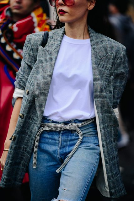 With white t-shirt, jeans and plaid jacket
