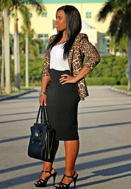 With white top, black midi skirt, tote bag and black shoes