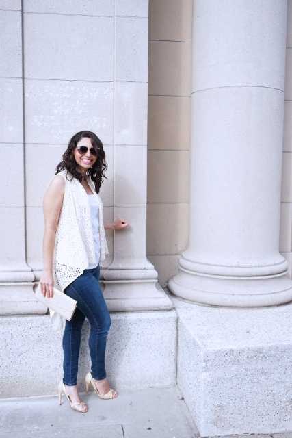 With white top, skinny jeans, white clutch and high heels