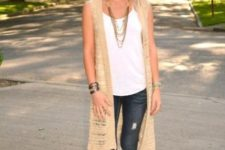 a nice spring outfit with a wide brim hat and a crochet vest