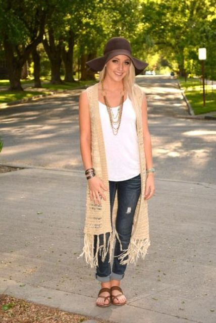 With white top, wide brim hat, distressed jeans and flat shoes