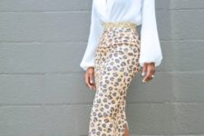 With white wrapped blouse and pale pink pumps