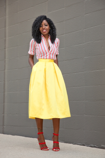 With yellow midi skirt and red shoes