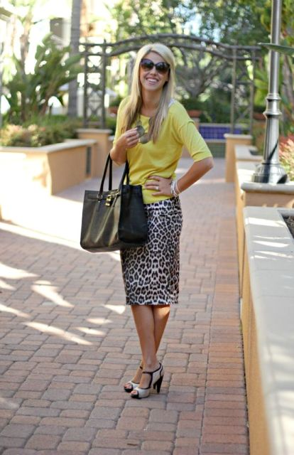 With yellow shirt, necklace, black tote and white and black shoes