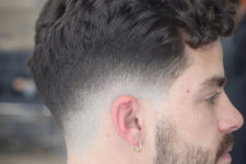 a low bald fade with a curly fringe is idea for guys with thick and wavy hair
