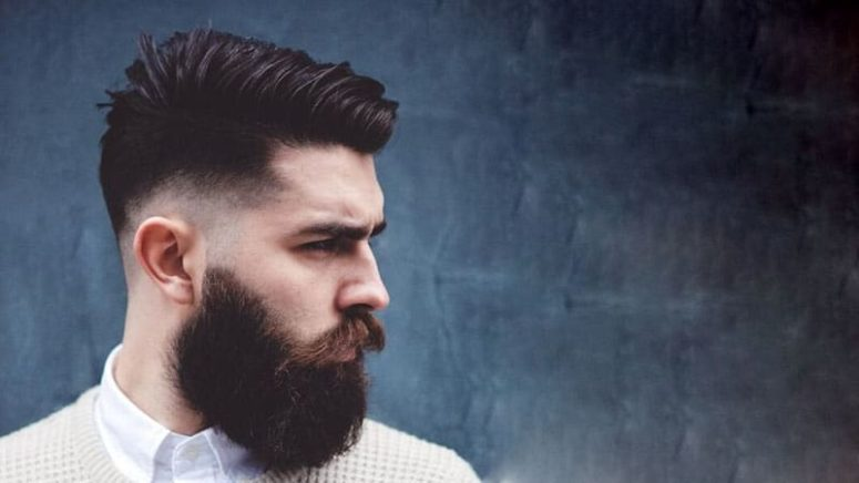 a low fade combover with a beard is a bold idea for a hipster