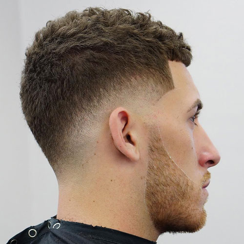 a low fade haircut features much texture on the sides and this beard accents the look even more