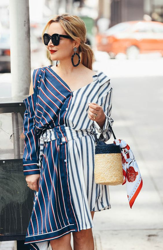 a cool dress with stripe prints in various colors and a wicker bucket bag for a sea holiday
