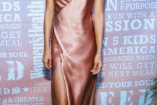 02 a copper slip maxi dress with a V-neckline and a geometric wrap design is a bold idea